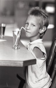 Nick as a child drinking from a straw